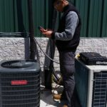 Ray checking refrigerant charge on an a/c unit