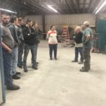 Shop Foreman Junior Brown and Dennis Poff answer questions from Kim and her students