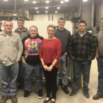 Jessica and the students stand in the Sheet Metal Shop