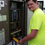 Charles taking voltage readings.
