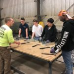 Sheet Metal Foreman Gerry Brown instructs students in the fine art of metal fabrication